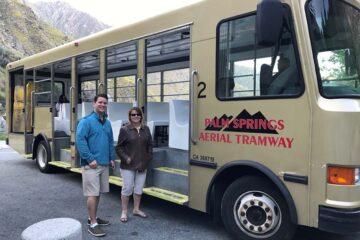 Elite Real Estate Network Members Next to Bus